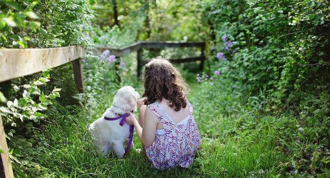Child with dog in a garden